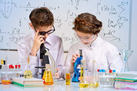 chemistry lesson: Students doing experiments in the laboratory. Science and education. Stock Photo
