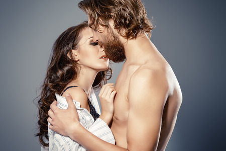 sex tenderness: Beautiful loving young people kissing. Passion. Love concept. Stock Photo