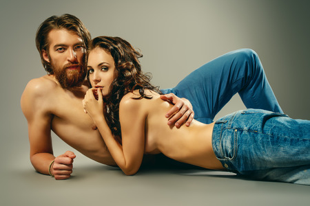 sex tenderness: Fashion portrait of a beautiful tender lovers. Denim style.