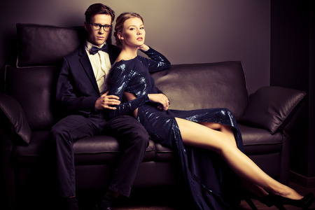 riches adult: Beautiful gorgeous couple in elegant evening dresses. Fashion, glamour. Stock Photo