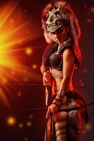 ancient times: Beautiful bellicose Amazon with bow and arrows in battle. Ancient times. Stock Photo