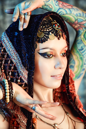 bellydance: Close-up portrait of a magnificent traditional female dancer. Ethnic dance. Belly dancing. Tribal dancing. Make-up, cosmetics. Stock Photo