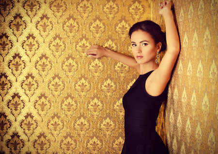 stunning: Beautiful elegant lady in vintage interior. Fashion shot.