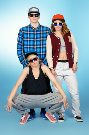 urban dance: Group of young modern people posing together with fun. Studio shot.