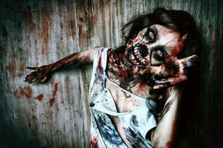 witch face: Close-up portrait of a scary bloody zombie girl. Horror. Halloween. Stock Photo