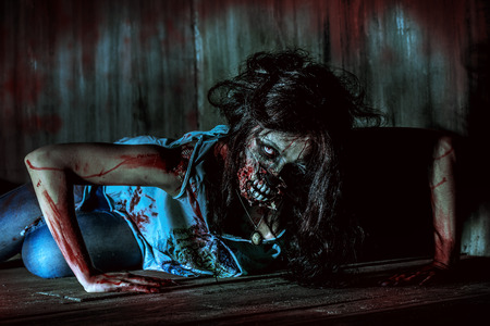 horrors: Furious bloody zombie girl. Horror. Halloween. Stock Photo