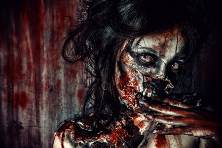 bloody: Close-up portrait of a scary bloody zombie girl. Horror. Halloween. Stock Photo
