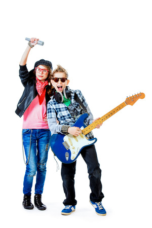 hardrock: Modern teenagers playing electric guitar and sing on a stage with expression. Isolated over white.