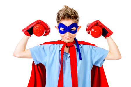 superman: A boy teenager in a costume of superhero. Isolated over white background.