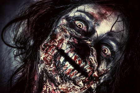 horrors: Close-up portrait of a scary bloody zombie girl. Horror. Halloween. Stock Photo