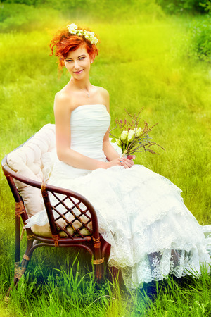 wedding accessories: Beautiful smiling bride with chaming red hair. Wedding dress and accessories. Wedding decoration. Stock Photo