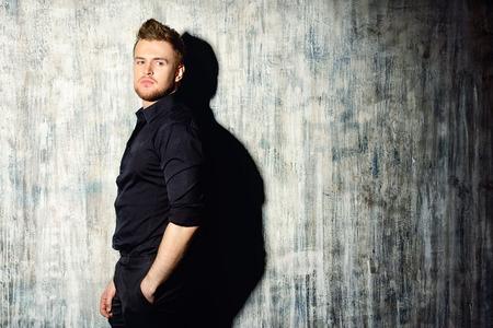 formal shirt: Fashionable man in black shirt posing at studio. Mens beauty, fashion. Stock Photo
