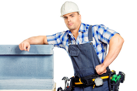 erector: Male construction worker in working clothes, helmet and tools. Isolated over white.