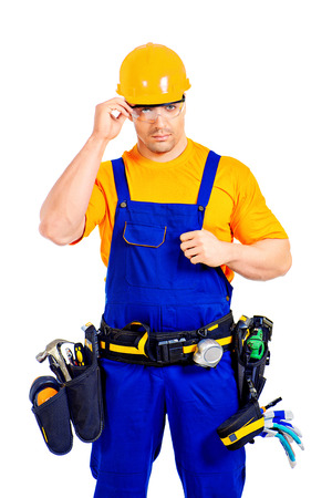erector: An industrial worker wearing uniform and tools. Job, occupation. Isolated over white.