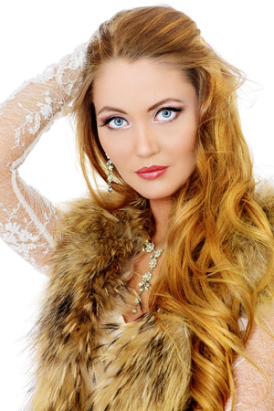 haircare: Beautiful young woman with long hair. Make-up, cosmetics. Jewelry. Haircare. Isolated over white.