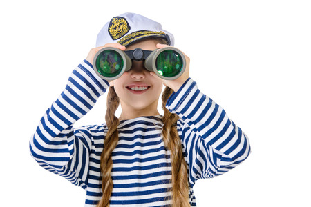 striped vest: Joyful teen girl wearing sailors striped vest and marine cap looking through binoculars. Studio shot. Isolated over white.