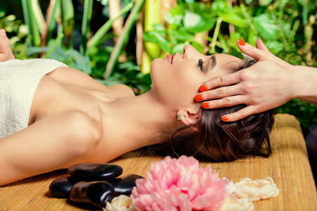 woman in spa: Manual therapy. Beautiful young woman getting massage at a spa salon. Healthcare, body care.