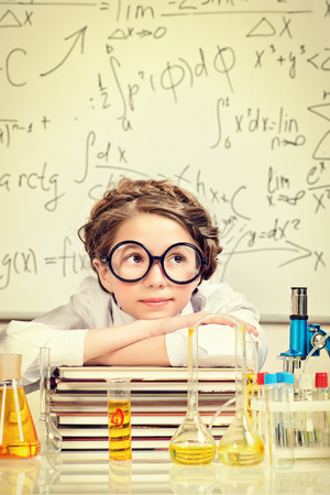 Student girl doing research in the laboratory. Science and education. photo