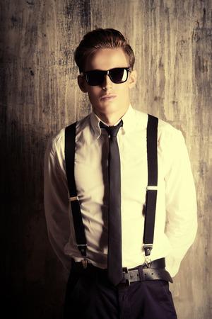 fop: Fashion shot of a handsome young man. Studio shot.