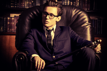respectable: Respectable handsome man in his office. Classic vintage style.