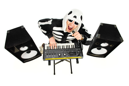 skeleton costume: Rock musician in a skeleton costume playing the synthesizer and singing. Music. Halloween. Stock Photo