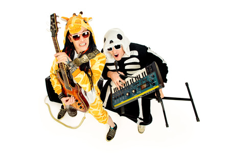 Rock band in costumes of  skeleton and giraffe playing the synthesizer and electric guitar and singing. Music show. Halloween. Isolated over white. photo