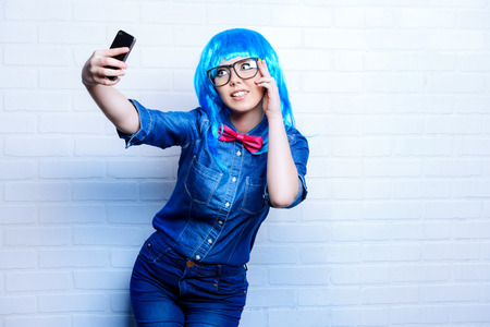 blue eyes girl: Selfie. Pretty teen girl taken pictures of her self. Beauty, fashion.