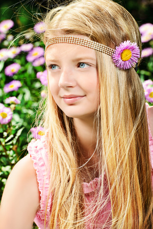 Portrait of a beautiful teenage girl in the summer park. Holiday. photo