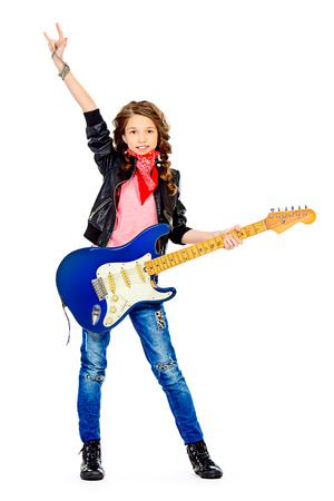 hardrock: Cute teen girl playing on her electric guitar. Isolated over white.