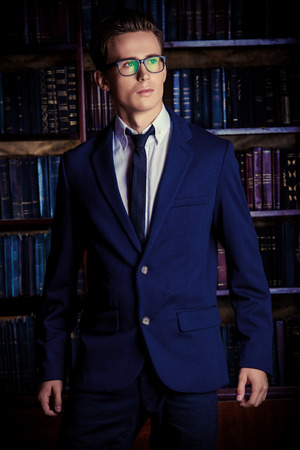 respectable: Close-up portrait of a respectable handsome man in his cabinet, library. Classic vintage style. Stock Photo