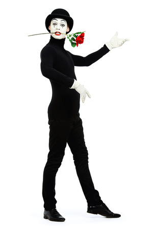 dramatic characters: Full length portrait of a male mime artist with red rose performing different emotions. Isolated over white.