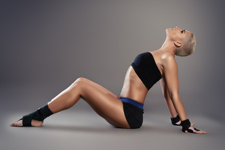 bodycare: Professional athlete woman bodybuilder with a perfect athletic physique. Fitness sports. Healthcare, bodycare.
