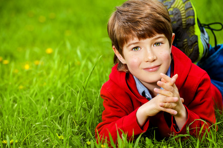 7 years old: Cute 7 years old boy having fun outdoor. Summer day. Stock Photo