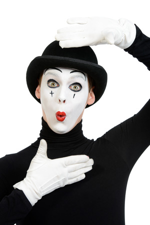 face paint: Portrait of a male mime artist. Isolated over white. Stock Photo
