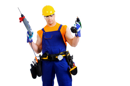 erector: Male construction worker with a drill. Job, occupation. Isolated over white. Stock Photo