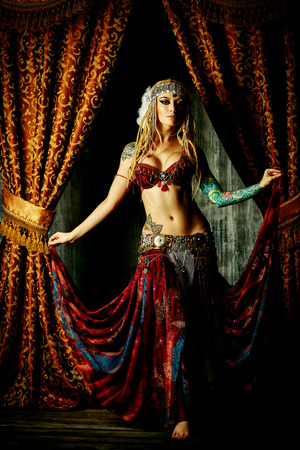 tribal dance: Beautiful traditional female dancer. Ethnic dance. Belly dancing. Tribal dancing.