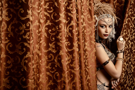BELLY DANCING: Beautiful traditional female dancer. Ethnic dance. Belly dancing. Tribal dancing.