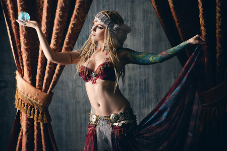 bellydance: Beautiful traditional female dancer. Ethnic dance. Belly dancing. Tribal dancing.