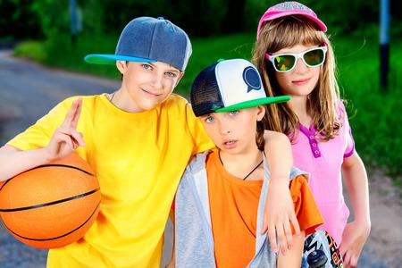 active lifestyle: Three joyful children in the park. Active lifestyle. Summer.