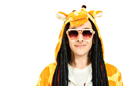 studio zoo: Rock musician in a costume of giraffe dancing and singing at studio. Zoo party. Entertainment, rock show. Isolated over white.