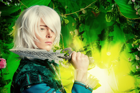 cosplay: Beautiful blond elf with a dagger in his hand in the magic forest. Fantasy. Anime style.