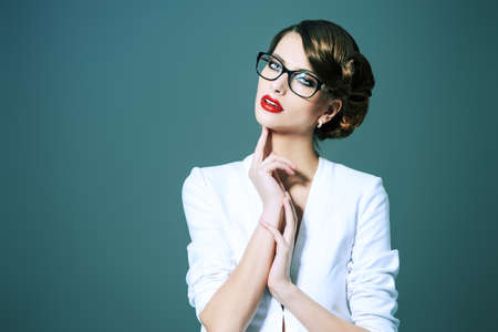gorgeous businesswoman: Close-up portrait of a gorgeous young woman wearing glasses. Beauty, fashion. Make-up. Optics, eyewear. Stock Photo