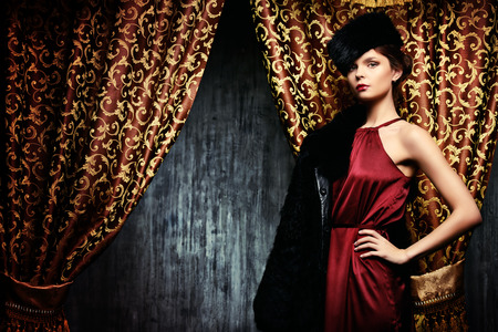 Beautiful young woman posing in fur. Luxury. Vintage style. Beauty, fashion. photo