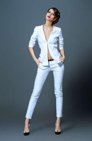 business model: Fashion shot of a beautiful model posing at studio. Beauty, fashion. Make-up.