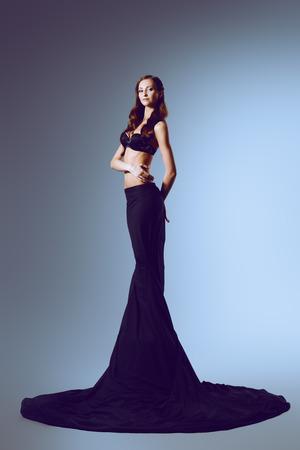 Fashion shot of a beautiful graceful woman with perfect figure. Studio shot. photo