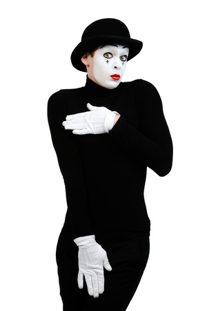 nakedness: Male mime artist showing shyness. Isolated over white.