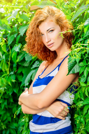 redhaired: Pretty young woman beautiful foxy hair outdoors. Beauty, fashion. Stock Photo