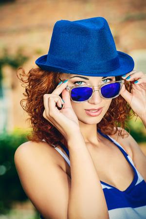 foxy girls: Attractive young woman beautiful foxy hair outdoors. Beauty, fashion.