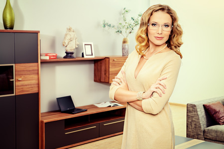 corporate women: Beautiful business woman standing standing in the office.