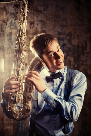 talent show: Portrait of a musician with his saxophone. Art and music. Jazz music.